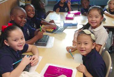 Happy faces with new school supplies!